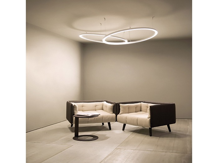 This circular suspension features an aluminum body and opal diffuser with led smd source for warm and diffusive light available in direct indirect and
